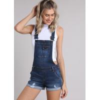 Jardineira Jeans Feminina Com Puídos E Barra Dobrada Azul Escuro