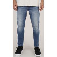 Calça Jeans Masculina Carrot Com Puídos Azul Escuro