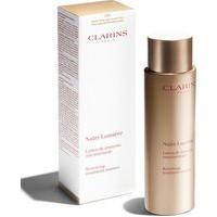 Loção Facial Anti Idade Nutri Lumiere Treatment Essence Clarins | Clarins | 200Ml